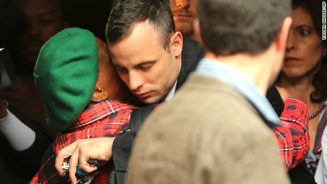 Oscar Pistorius is hugged by a woman as he leaves court in Pretoria, South Africa, on Wednesday, April 16. Pistorius, the first double amputee runner to compete in the Olympics, is accused of intentionally killing his girlfriend, Reeva Steenkamp, in February 2013. Pistorius has pleaded not guilty to murder and three weapons charges.