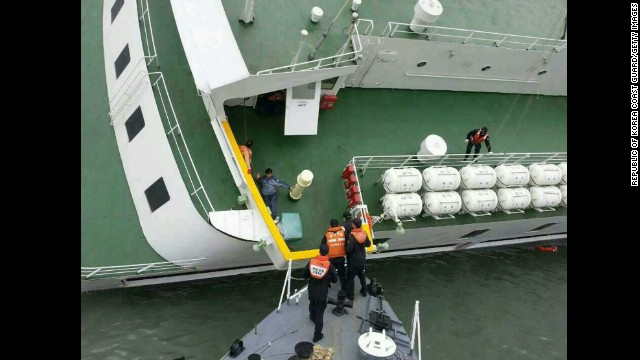 A passenger is rescued from the sinking ship on April 16.