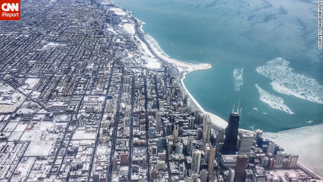 David Nevolo caught this <a href='http://ireport.cnn.com/docs/DOC-1121641'>aerial view</a> from a commercial airliner on New Year's Eve 2013. The flight path into O'Hare goes right over downtown.