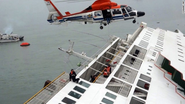 A South Korean coast guard helicopter lifts passengers off the vessel on April 16.