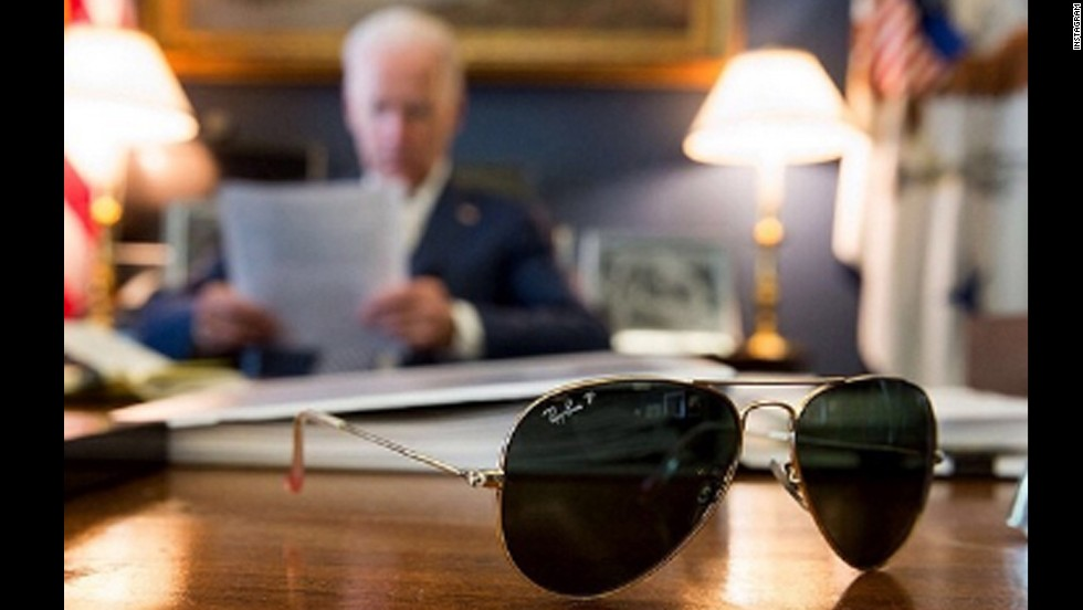 U.S. Vice President Joe Biden has joined the popular photo-sharing website Instagram, and <a href='http://instagram.com/p/m264zNlwTT/' target='_blank'>the first uploaded picture</a> shows Biden's aviator glasses with the vice president reading in the background. The caption with the photo said Biden will travel to Pennsylvania to tout a jobs plan with President Obama, and it promised more pictures of Biden's sunglasses to come. Click through the gallery to see more photos of Biden and what has become his signature eyewear.