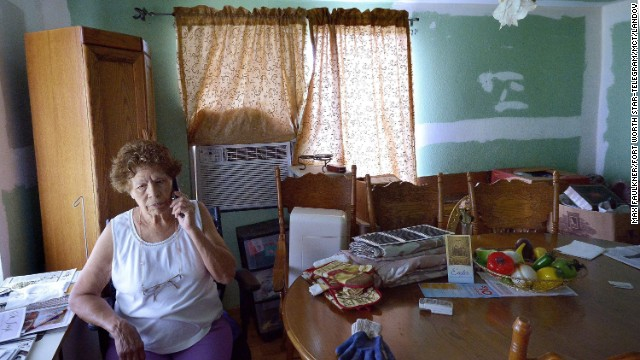 Eleanor Castro sits in her home in West, Texas. Her property was damaged by the fertilizer plant explosion a year ago that claimed 15 lives.