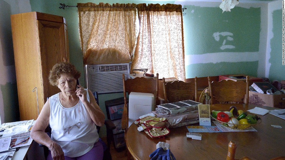 Eleanor Castro sits in her home in West, Texas. Her property was damaged by the <a href='http://www.cnn.com/2013/04/18/us/gallery/texas-explosion/index.html'>fertilizer plant explosion</a> a year ago that claimed 15 lives.