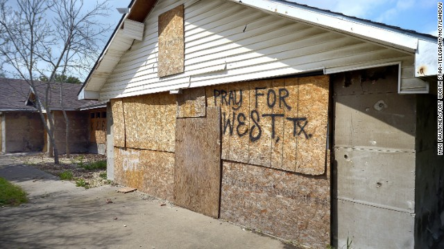 A damaged home remains boarded up in a hard-hit neighborhood.