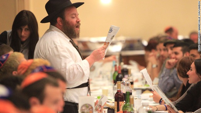 Rabbi Berl Goldman of the Lubavitch-Chabad Jewish Student and Community Center addresses more than 600 attendees during the Passover Seder at the Chabad House in Gainesville, Florida, on April 14.