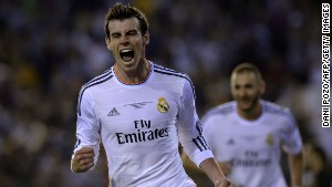 Gareth Bale celebrates after scoring the winning goal for Real Madrid in the Copa del Rey final against Barcelona.
