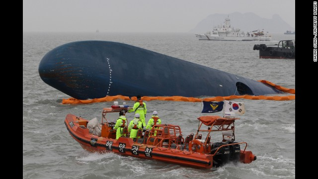 South Korean Coast Guard members and rescue teams search for passengers at the site of the sunken ferry on April 17.
