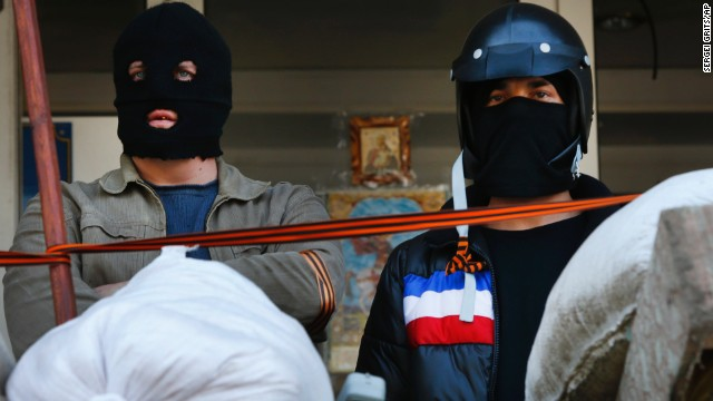 Masked pro-Russian protesters stand guard in front of the city hall in Mariupol, Ukraine, on April 17.
