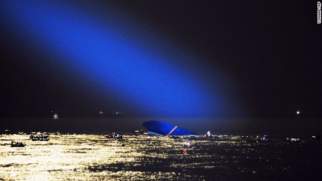 A searchlight illuminates the Sewol, a capsized South Korean ferry, in the waters of the Yellow Sea near Jindo, South Korea, on Thursday, April 17. It is not yet known what caused the ship to sink.