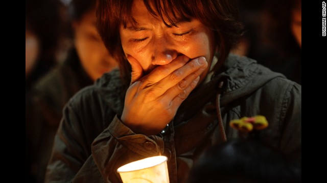 A woman cries during a candlelight vigil at Danwon High School in Ansan, South Korea, on April 17. Most of the people on board the ferry were high school students on their way to the resort island of Jeju.