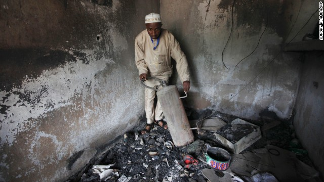 An official displays burned equipment inside a prison in Bauchi, Nigeria, on September 9, 2010, after the prison was attacked by suspected members of Boko Haram two days earlier. About 720 inmates escaped during the prison break, and police suspect the prison was attacked because it was holding 80 members of the sect.