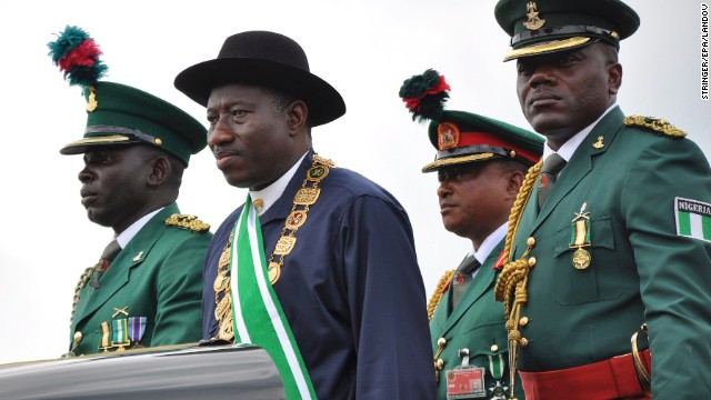 Nigerian President Goodluck Jonathan, second from left, stands on the back of a vehicle after being sworn-in as President during a ceremony in the capital of Abuja on May 29, 2011. In December 2011, Jonathan declared a state of emergency in parts of the country afflicted by violence from the militant Islamist group.
