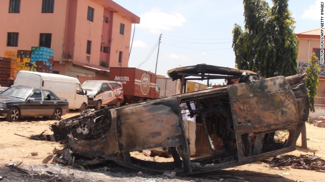A photo taken on June 18, 2012, shows a car vandalized after three church bombings and retaliatory attacks in northern Nigeria killed at least 50 people on June 17 and injured more than 130 others, the Nigerian Red Cross Society said.