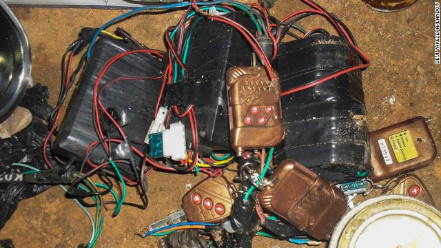 A photograph made available by the Nigerian army on August 13, 2013, shows improvised explosive devices, bomb making materials and detonators seized from a Boko Haram hideout. Gunmen attacked a mosque in Nigeria with automatic weapons on August 11, 2013, killing at least 44 people.