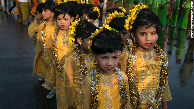 APRIL 17 - YANGON, MYANMAR: Young Burmese dancers wearing traditional clothing wait to take part in the closing ceremony on the fourth day of the Burmese new year water-throwing festival called Thingyan on April 16.