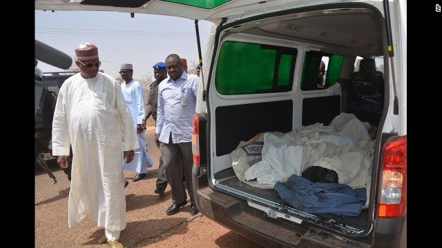 Ibrahim Gaidam, governor of Yobe state, left, looks at the bodies of students inside an ambulance outside a mosque in Damaturu. At least 29 students died in an attack on a federal college in Buni Yadi, near the the capital of Yobe state, Nigeria's military said on February 26. Authorities suspect Boko Haram carried out the assault in which several buildings were also torched. In April as many as 200 girls were abducted from their boarding school in northeastern Nigeria by heavily armed Boko Haram Islamists who arrived in trucks, vans and buses, officials and witnesses said. The group has recently stepped up attacks in the region, and its leader released a video last month threatening to kidnap girls from schools.