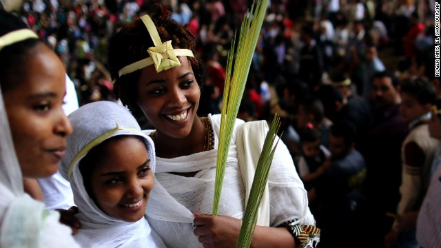 Egyptian Christians celebrate Palm Sunday during a service in the Samaan el-Kharaz Church in the Mokattam district of Cairo, Egypt, on April 13.