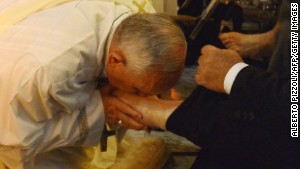 Pope washes feet of disabled people