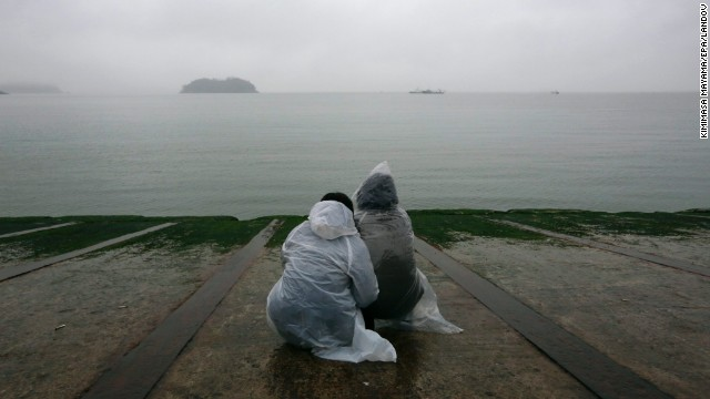 Relatives of missing people aboard the Sewol look out over the waters of the Yellow Sea on April 18.
