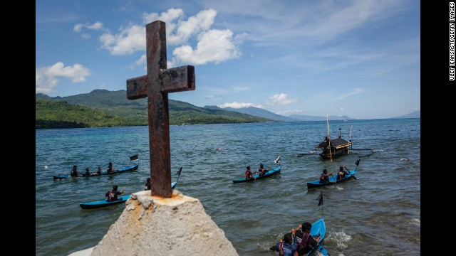 Catholic worshippers perform a sea procession to transfer a statue of Jesus Christ from one church to another April 18 in Larantuka, Indonesia.