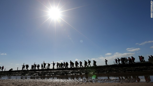 People walk with crosses April 18 as the Northern Cross pilgrimage makes the final leg of its journey to Holy Island, England.