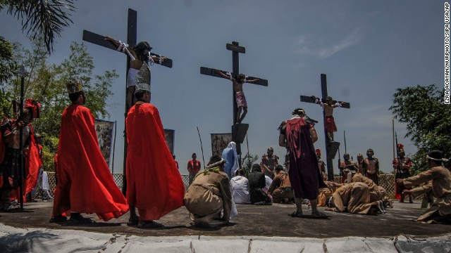 Penitents in San Fernando, Philippines, hang from wooden crosses on Good Friday as they take part in a re-enactment of Jesus Christ's crucifixion.