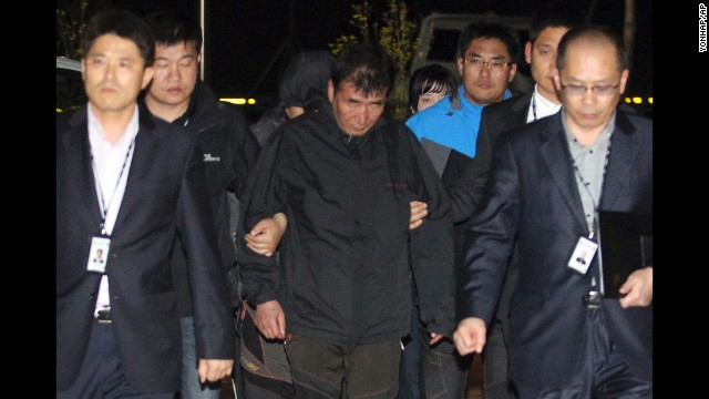 Lee Joon Suk, the captain of the sunken ferry Sewol, is escorted to the court that issued his arrest warrant Friday, April 18, in Mokpo, South Korea. It is not yet known what caused Wednesday's deadly accident.