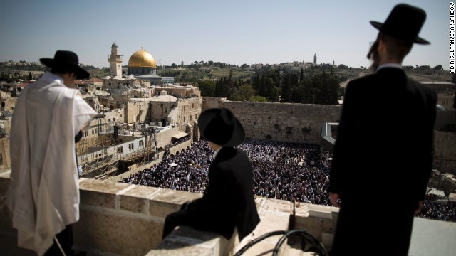 Ultra-Orthodox Jews watch others recite the Cohanim prayer, or priestly blessing, in front of the Western Wall in Jerusalem on Thursday, April 17.