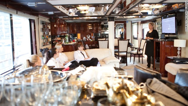 "Here, they take notes from chief stewardess Titta, while on board 30-meter vessel ""Absolute Pleasure"" -- their home and classroom for a five-day training course."