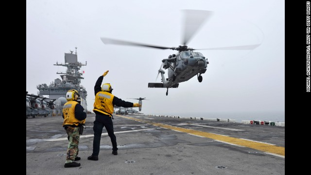 A U.S. helicopter takes off from the flight deck of the USS Bonhomme Richard during search-and-rescue operations on April 18.