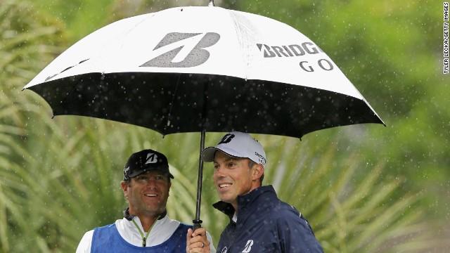 Matt Kuchar takes cover under an umbrella at the RBC Heritage in South Carolina.