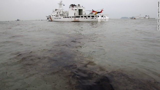 Oil from the sunken ferry appears near the wreckage site on April 19.