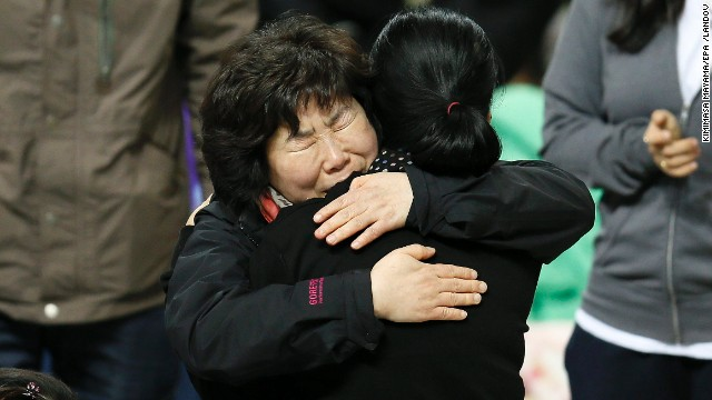 Family members of missing passengers hug as they await news of their missing relatives at Jindo Gymnasium in the southwestern province of South Jeolla, South Korea, on April 19.