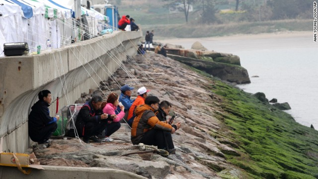Relatives of missing passengers wait on the shore in Jindo on April 19.