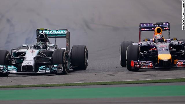 Nico Rosberg in his Mercedes sweeps past Sebastian Vettel as he works his way through the field after a poor start in Shanghai.