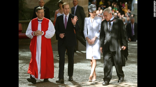 Britain's Prince William, second from left, and his wife, the Duchess of Cambridge, walk with Archbishop Glenn Davies, left, and the Rev. Phillip Jensen, dean of Sydney at St. Andrew's Cathedral, as they arrive at the cathedral for Easter Sunday church services in Sydney.
