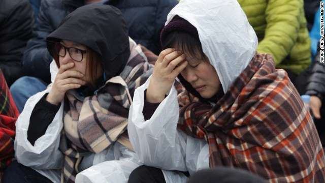 Relatives of missing passengers from the Sewol ferry grieve on April 20 in Jindo.