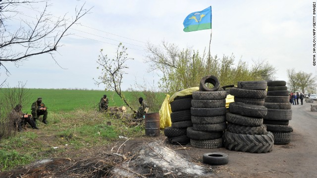 Armed pro-Russian militants stand guard at the roadblock near Slavyansk on April 20.