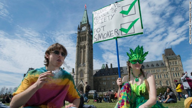 People gather on the lawns of Parliament Hill during the Fill the Hill marijuana rally in Ottawa on April 20.