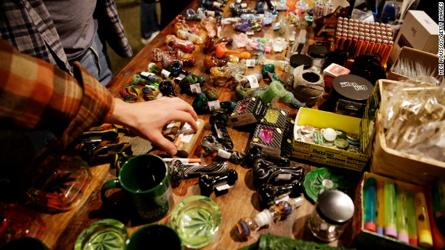 Attendees look at glass pipes used for smoking marijuana being sold at Hempfest on April 20 in Seattle.