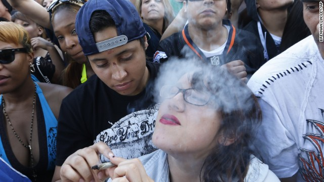 Partygoers listen to live music and smoke pot on day two of the annual 420 Rally in Denver on Sunday, April 20, 2014. 420 is a once clandestine term used in pot culture to refer to marijuana.