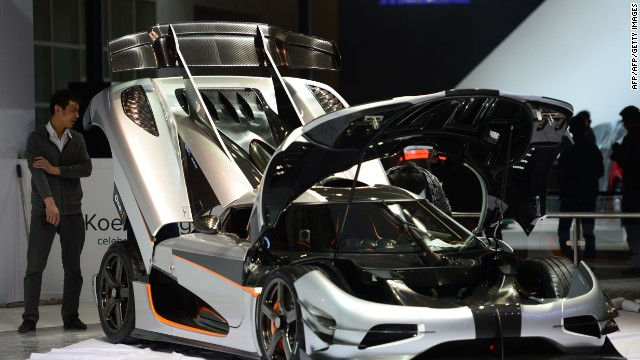 Beijing police estimate an average of 120,000 people will visit the exhibition each day. This image shows a Koenigsegg car being installed at the venue.