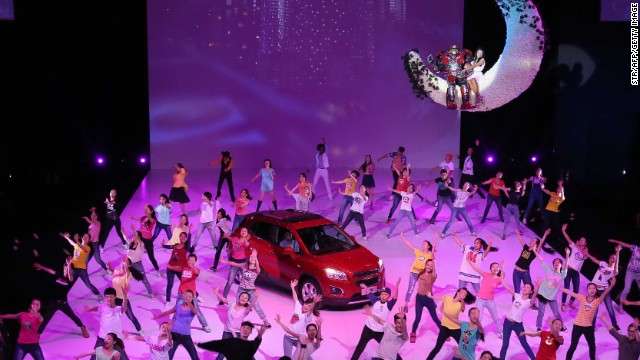 Dancers perform during Chevrolet's gala evening held ahead of the Beijing Auto Show. The exhibition of fashionable high-end cars features more than a thousand vehicles and is open to the public until April 29.