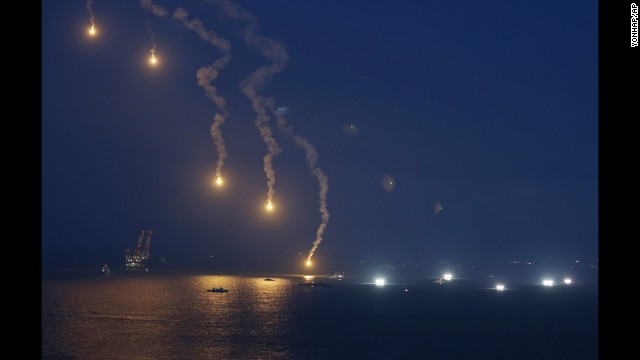 Search operations continue as flares illuminate the scene near Jindo on Sunday, April 20.