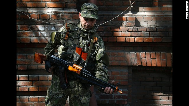 An armed pro-Russian man stands on a street in Slavyansk on Monday, April 21.