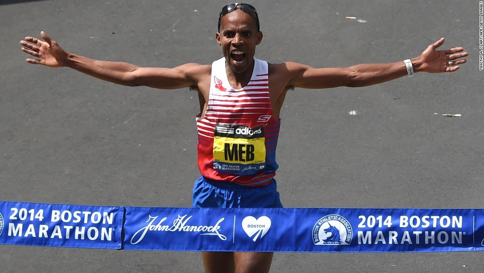 Meb Keflezighi of the United States crosses the finish line to win the men's division of the Boston Marathon in downtown Boston on Monday, April 21.