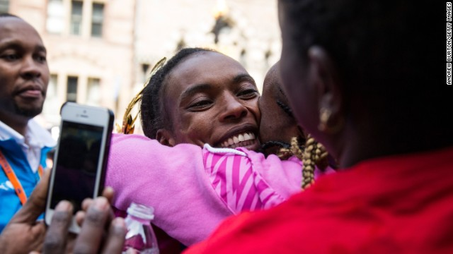 Jeptoo hugs fans after placing first in the women's division.