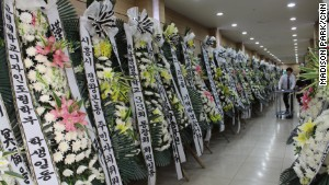 Flowers for Sewol crew member Park Jee Young pack a hallway at a funeral home in Incheon, South Korea.