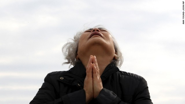 A relative of a passenger aboard the ferry prays as she waits for news in Jindo on April 22.