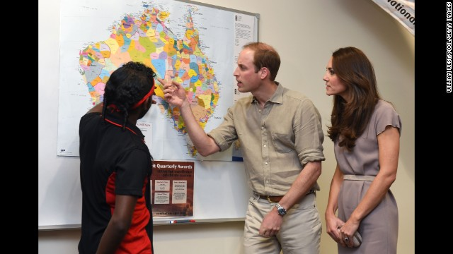 The royal couple look at an aboriginal map showing the location of indigenous language groups before European settlement during a visit to the National Indigenous Training Academy at Yulara in Ayers Rock, Australia, on April 22.